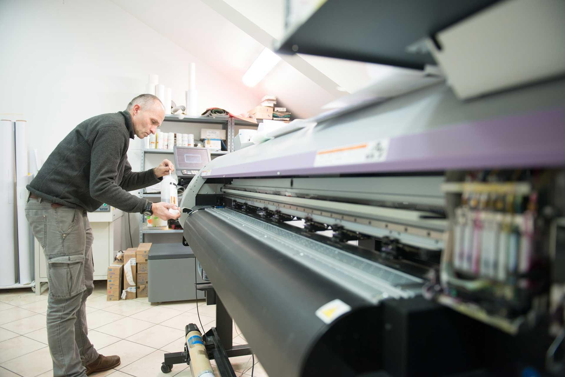 technician_swabbing_clean_large_format_printer