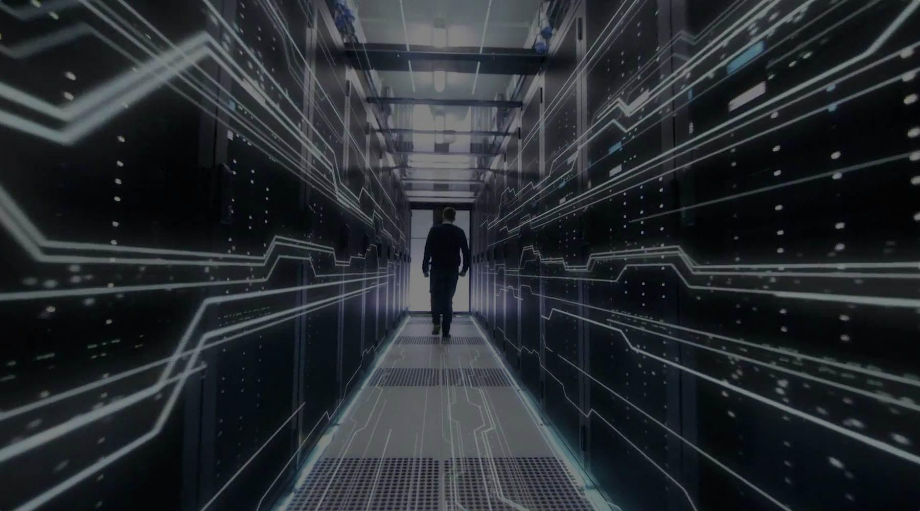 Man-standing-in-server-room-dark