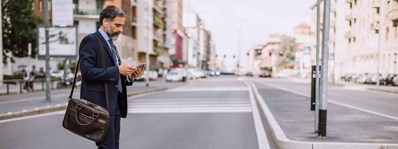 man_on_cell_phone_walking_in_crosswalk