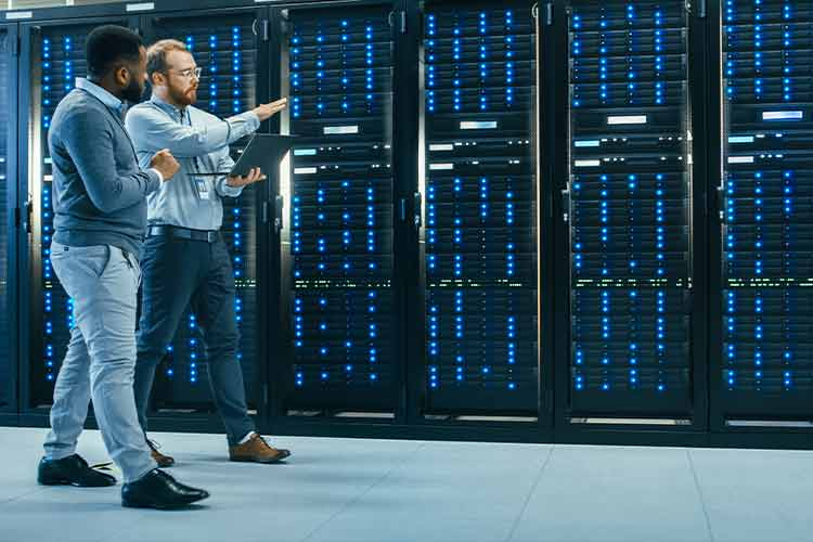 two_men_walking_through_data_center_talking