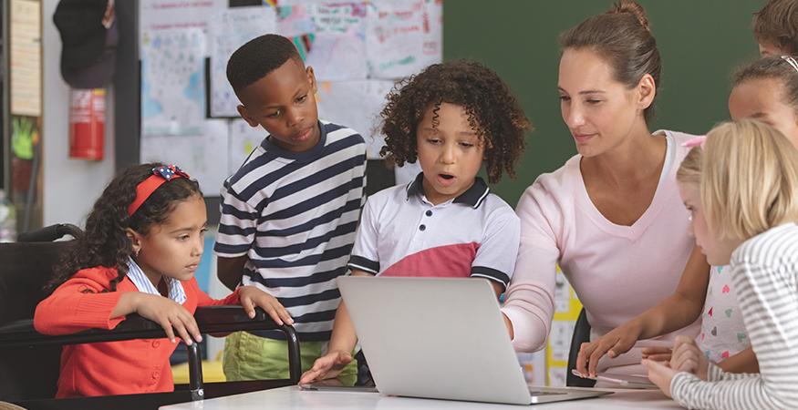 woman teaching kids on laptop
