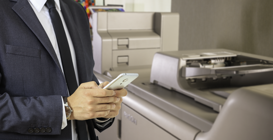 man on phone next to printer