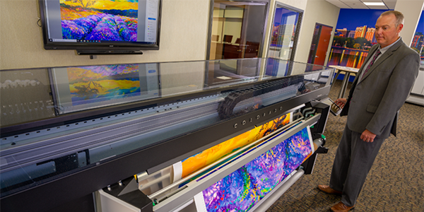 A large format printer printing a high resolution image.