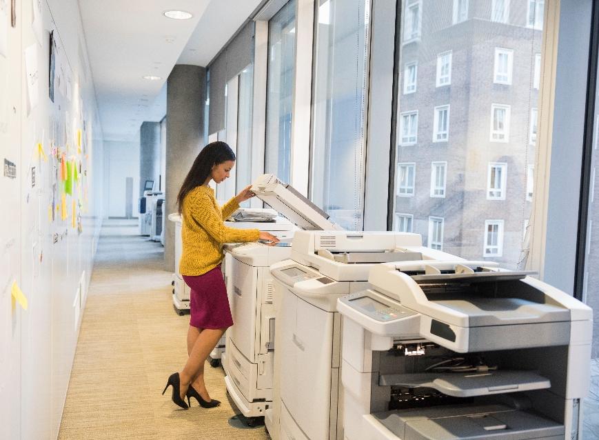 Gordon Flesch employee working on their printer fleet in an office.